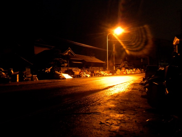 Photos of a tsunami damaged street in Kitaibaraki at night