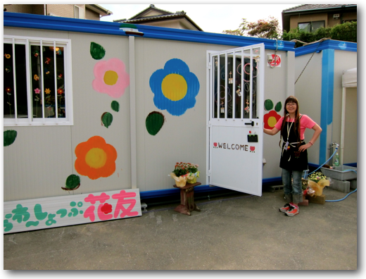Mrs Suzuki at her temporary flower shop entrance