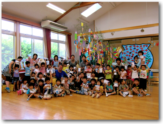 Socks for Japan with kindergartners in front of a Tanabata wish tree