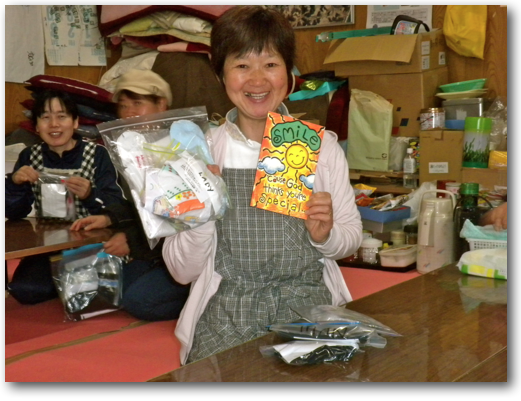 One survivor happy to receive socks in Minami Sanriku
