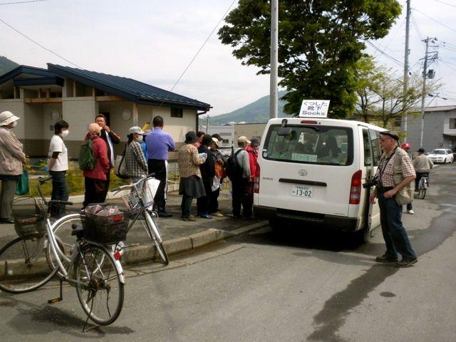 May 21, 2011: Socks for Japan Distributing Socks to Survivors as Prof. Jose Holguin-Veras Looks On