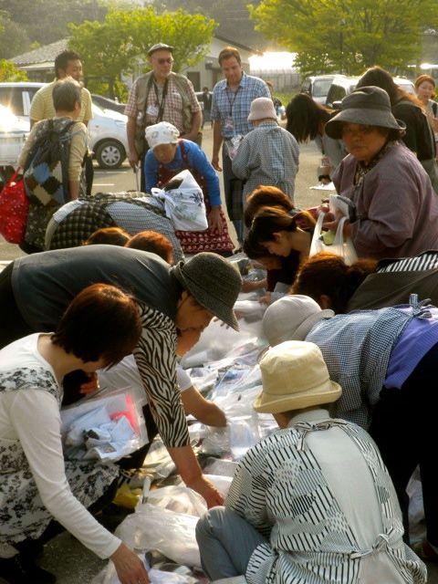 May 21, 2011: Socks for Japan Distribution in Higashi Matsushima as Jason Kelly, Prof. Jose Holguin-Veras, and Koutaro Ogata Look On