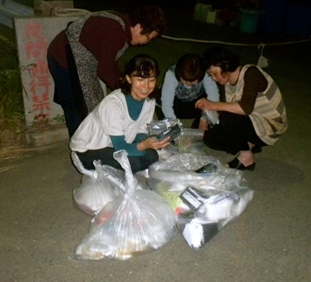 May 21, 2011: Socks for Japan Sock Recipients Looking Happy After Dark in Higashi Matsushima