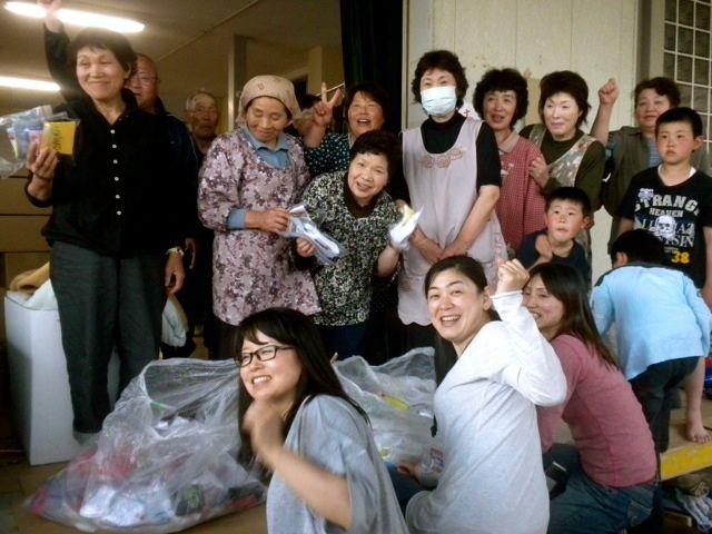 May 21, 2011: Socks for Japan volunteers Rumiko and Miwa Distributing Socks at a Shelter in Higashi Matsushima