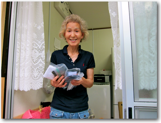 Fashionable grandmother receiving socks in her temporary home