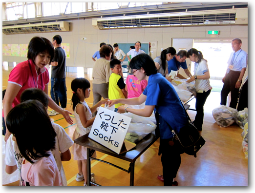 Socks for Japan distributing to Ishinomaki elementary students