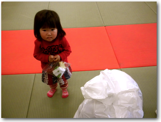 Little red survivor girl in Minami Sanriku